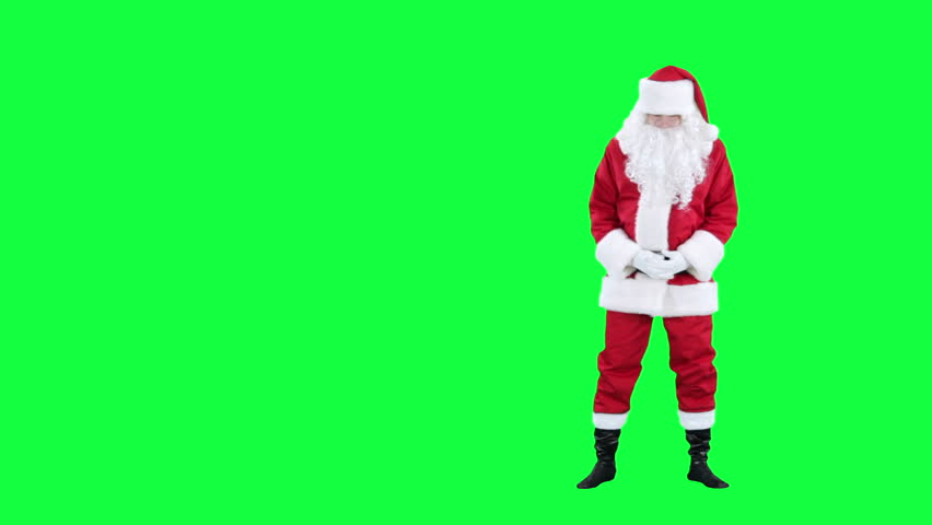 Santa Claus looks at something chroma key (green screen). Santa stares at something isolated on green
