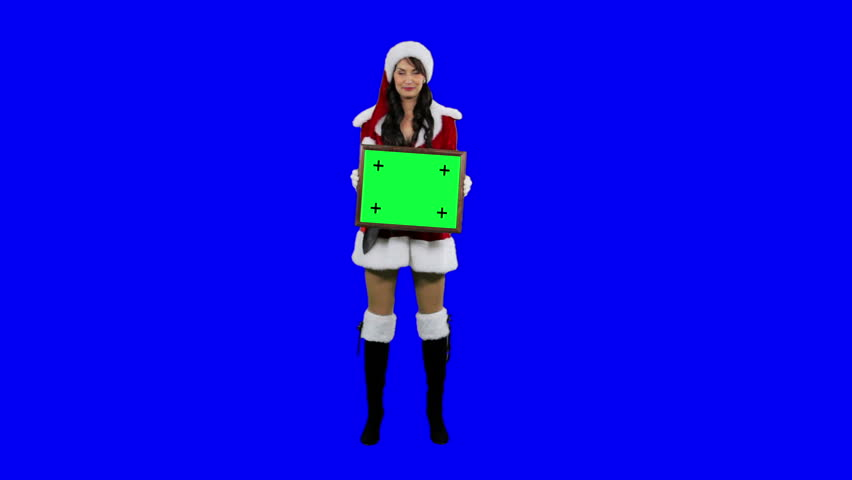 Sexy Santa's helper demonstrates frame for tracking chroma key (green screen). Sexy Santa girl holds the frame in her hands