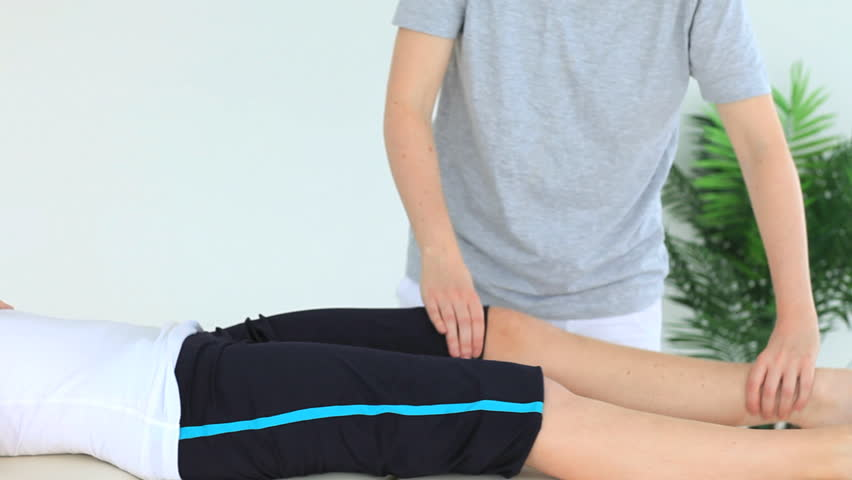 Woman doing some exercises helped by a physiotherapist - HD stock footage clip
