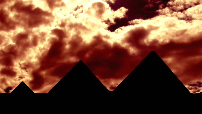 Pyramids in Egypt, near Kairo, with the cloudy sunset. - HD stock footage clip