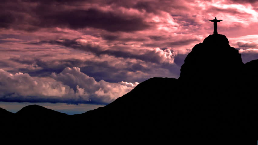 Statue of Christ on Sugarloaf, in Rio de Janeiro, Brasil, with the storm formating behind as the sun fells down. - HD stock footage clip