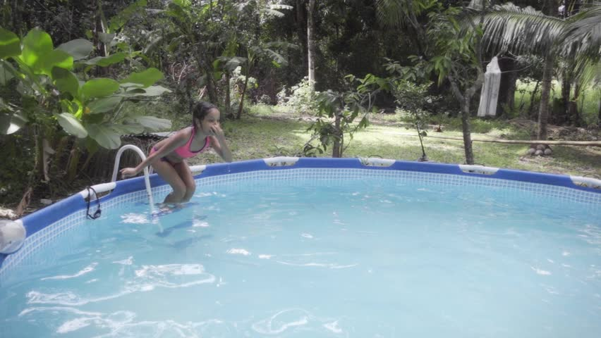 Hispanic Girl Pool Jumping Into The Water Slow Motion Stock Footage Video 12330605 Shutterstock