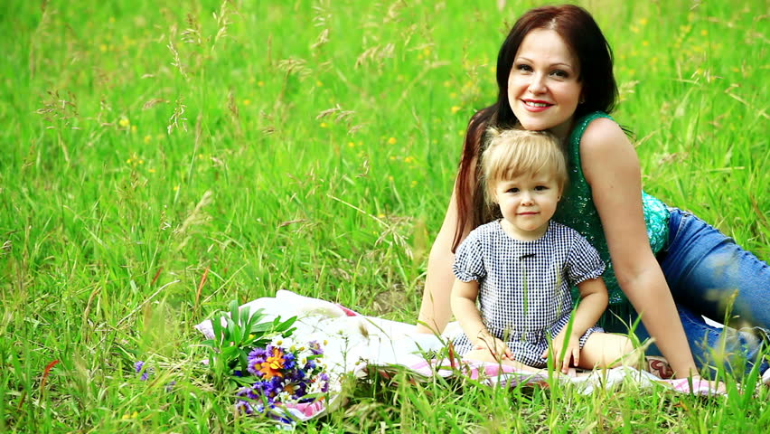 Mother and baby lying in the meadow    Shutterstock HD Video #1231660