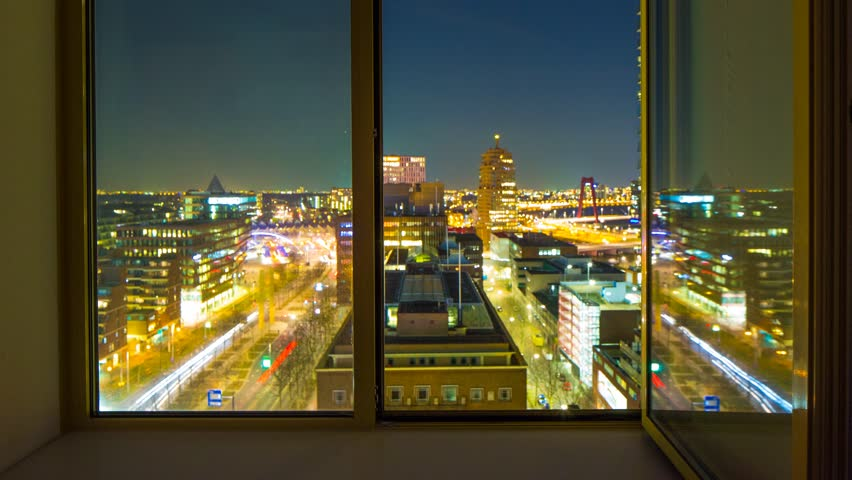 A static time-lapse at night with long exposure of a window in the European city, Rotterdam, the Netherlands, May 2015