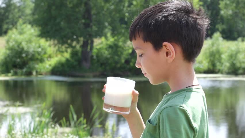 boy drinks milk - HD stock footage clip