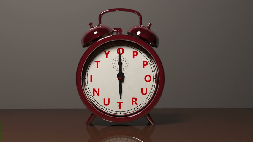 "A red old fashioned type of Alarm Clock with letters spelling out ""Oppourtunity"" goes off and rings moving the alarm clock off its' feet."