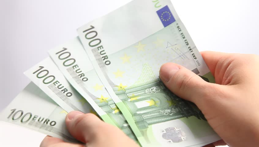 Unrecognizable businesswoman holding euro