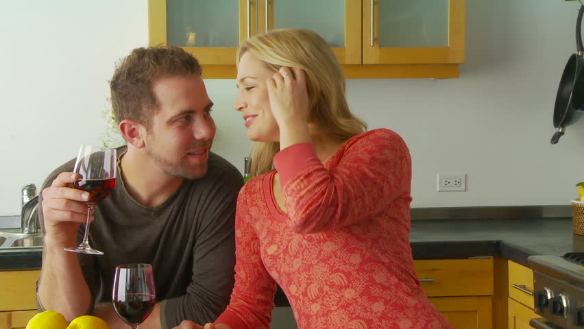 Young couple being playful and romantic in kitchen - HD stock video clip