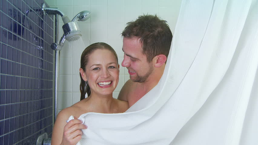 young couple in love taking a shower together