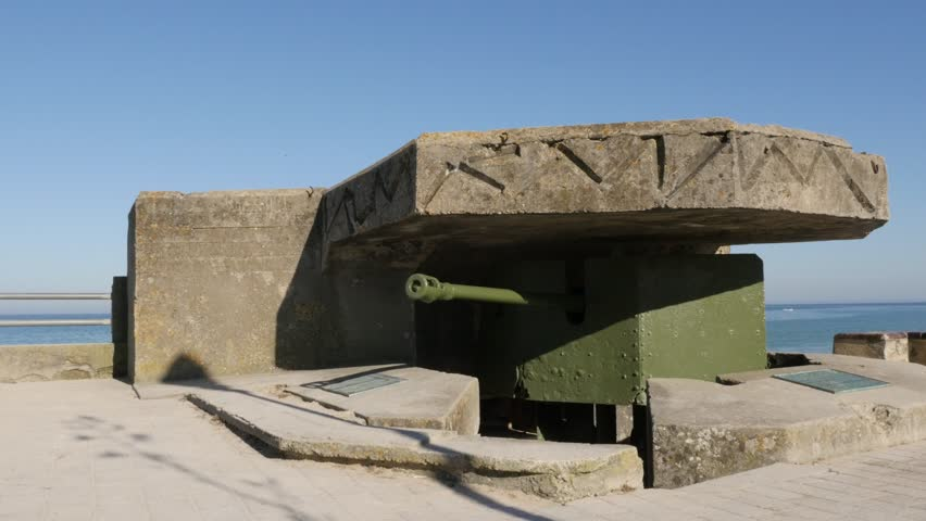 Old German WW2 canon hidden in bunker on beaches in northern France Normandy 4K 3840X2160 30fps UltraHD footage - World War 2 canon inside German bunker French beach  4K 2160p UHD video - 4K stock footage clip