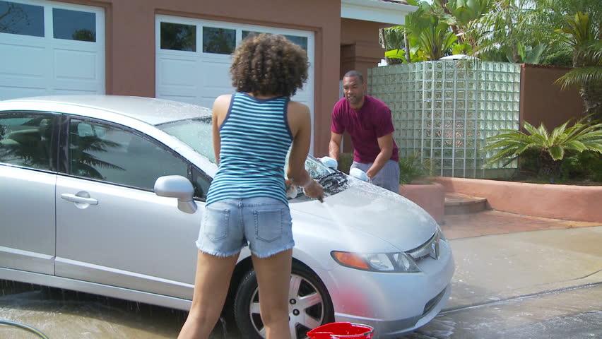 Woman At Car Wash Scrubbing Inside Of Car