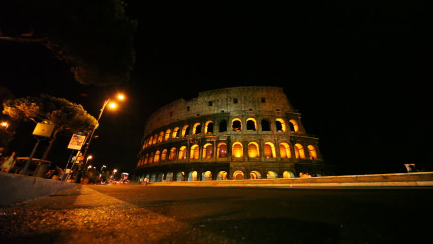 street with cars near illuminated Colosseum in Rome at night - HD stock footage clip