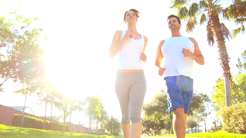Athletic caucasian couple jogging to keep fit - HD stock video clip