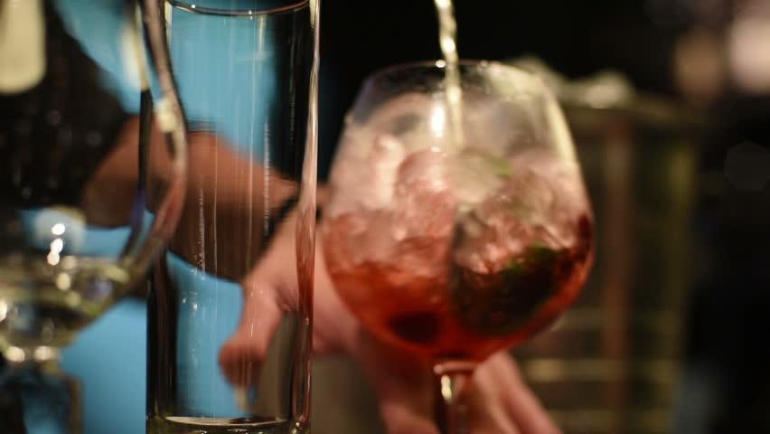Closeup photo in a bar where barmen makes cocktail