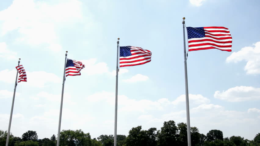 Four flags in a row blowing in wind - HD stock video clip