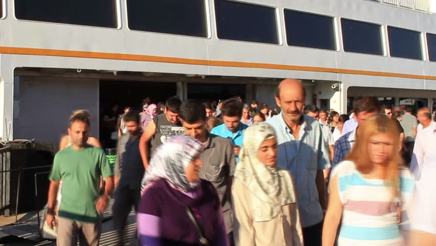 ISTANBUL - JULY 22: Unidentified commuters get off city ferryboat on July 22,