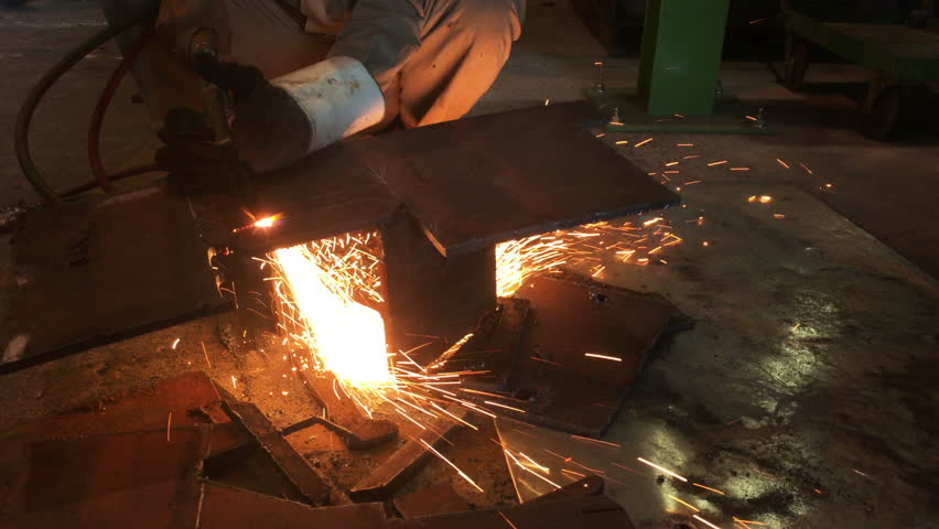Industrial worker cutting steel by using metal torch. UHD 4K 3840x2160.   - 4K stock video clip