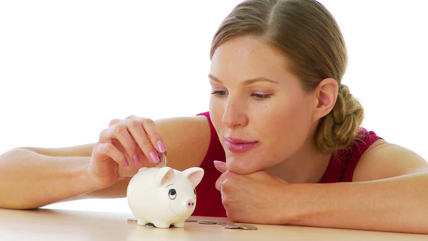 Woman putting money in piggy bank - HD stock footage clip