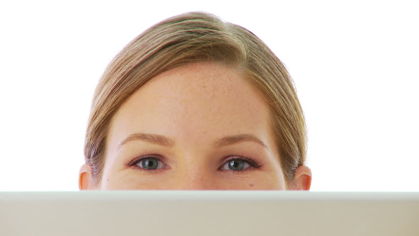 Close up of surprised eyes over laptop - HD stock footage clip