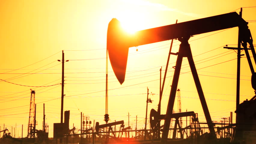 Crude oil production at sunset in remote desert location - HD stock video clip