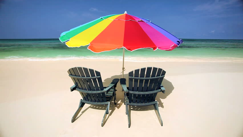 beach chairs parasol on luxury island stock footage. Black Bedroom Furniture Sets. Home Design Ideas