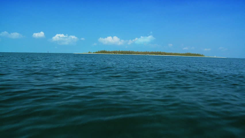 Aqua green waters with a beautiful Island beach in a tropical location - HD stock video clip