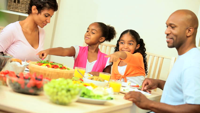 Young african american family sharing a healthy lunch together at home