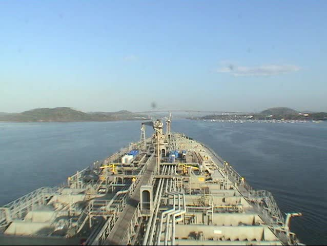 A time lapse of a tanker sailing through the Panama canal in 60 seconds from Pacific ocean to Atlantic ocean - SD stock video clip