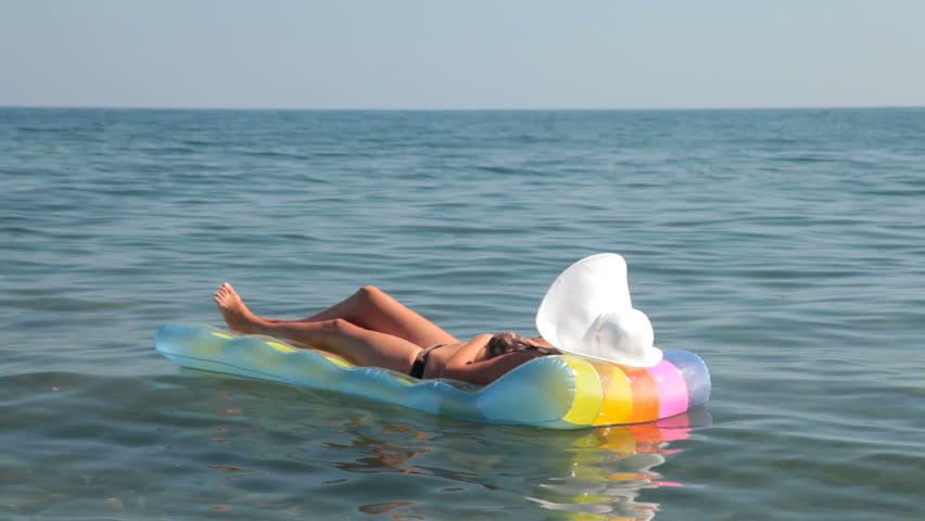 unrecognizable woman in bikini relaxing on raft - HD stock video clip
