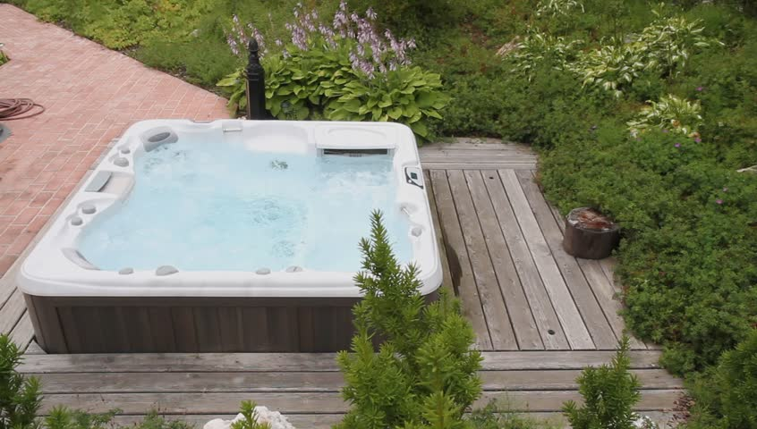 Jacuzzi in the garden - HD stock video clip
