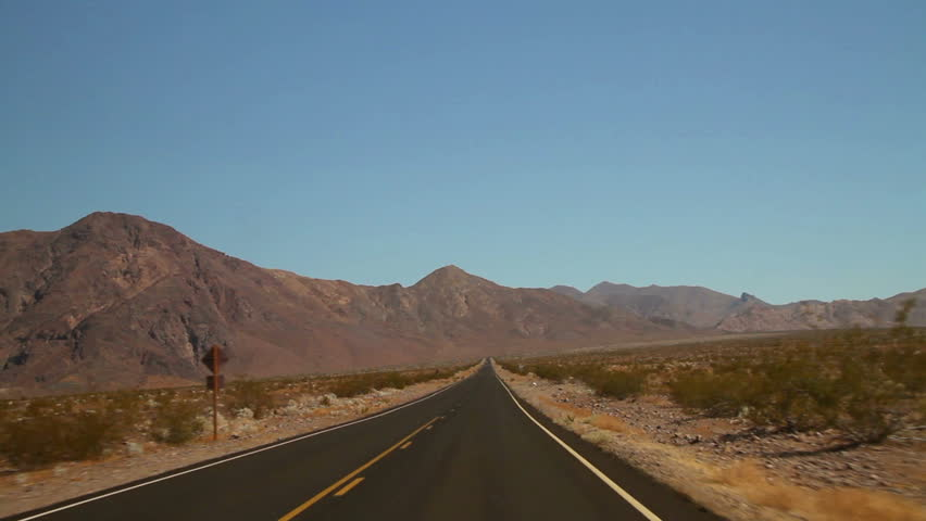 Driving shot on an empty road in Death Valley National Park - HD stock footage clip