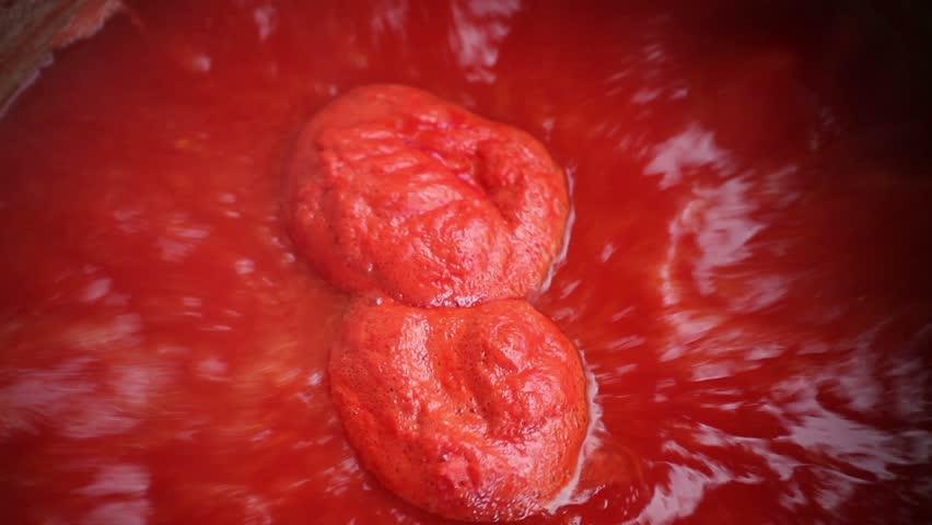 Farm tomato juice cooking.  | Shutterstock HD Video #1338868