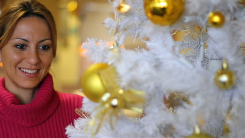Decorating Christmas tree - HD stock footage clip