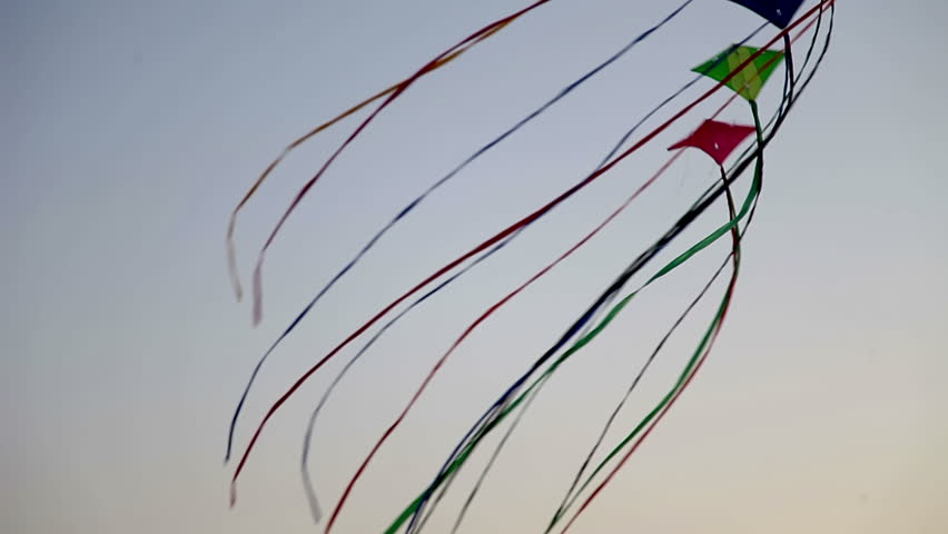 a line of kites attached together flying in the air - HD stock video clip