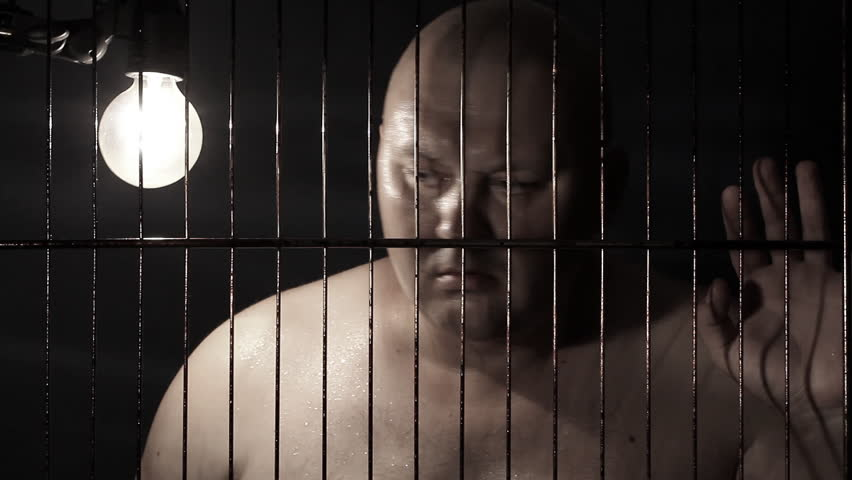 Prisoner in jail cell - HD stock footage clip