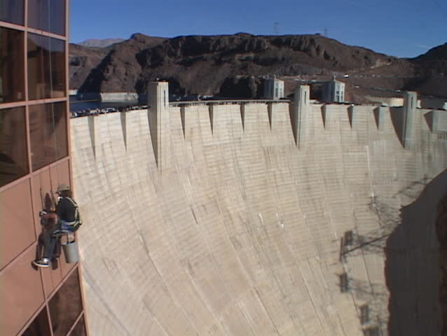 A window washer works at the Hoover Dam. - SD stock footage clip