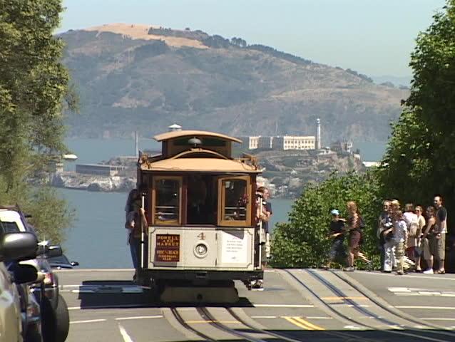 SAN FRANCISCO, CA - CIRCA 2010: Pedestrians board a cable car in San Francisco circa 2010 in San Francisco.