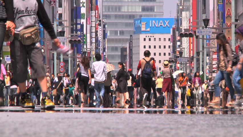 Tokyo Street - Ginza  Famous shopping area of Tokyo with people on the street.Low angle. April 2010 Japan - HD stock footage clip