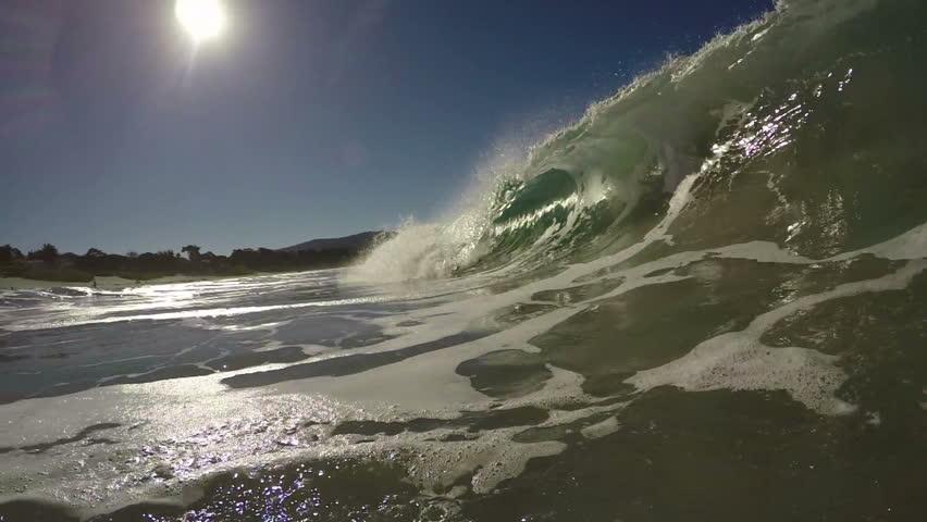 Ocean Wave breaking in clear water near the beach in California.  Filmed in High Definition Slow Motion Video.