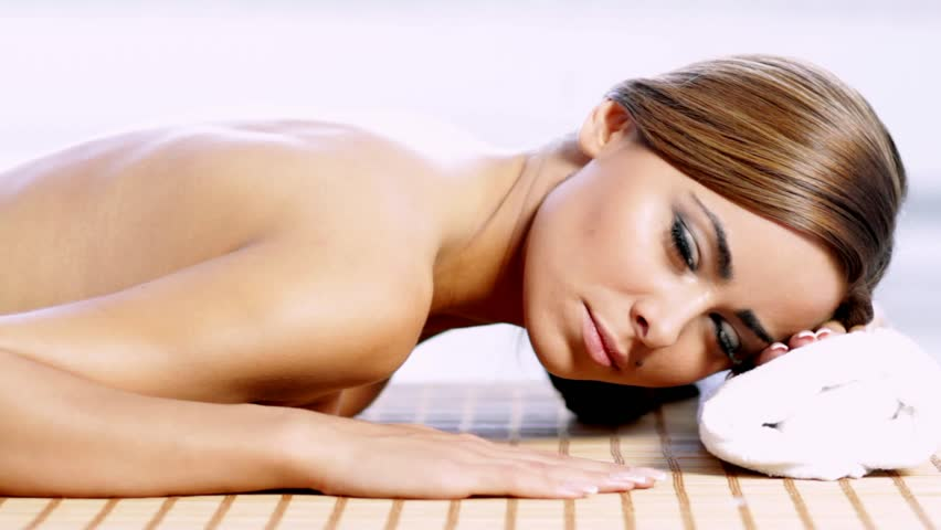 Sexy brunette woman getting spa treatment - HD stock footage clip