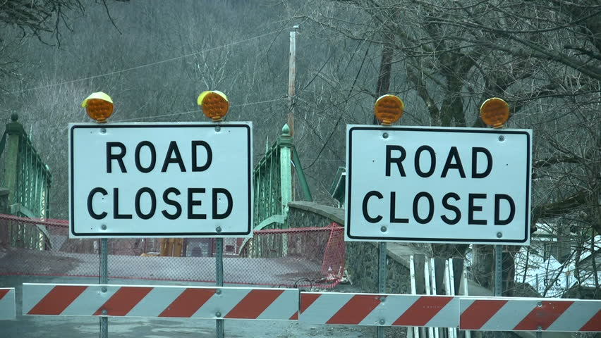 Flashing lights with road closed signs block off a bridge - HD stock footage clip