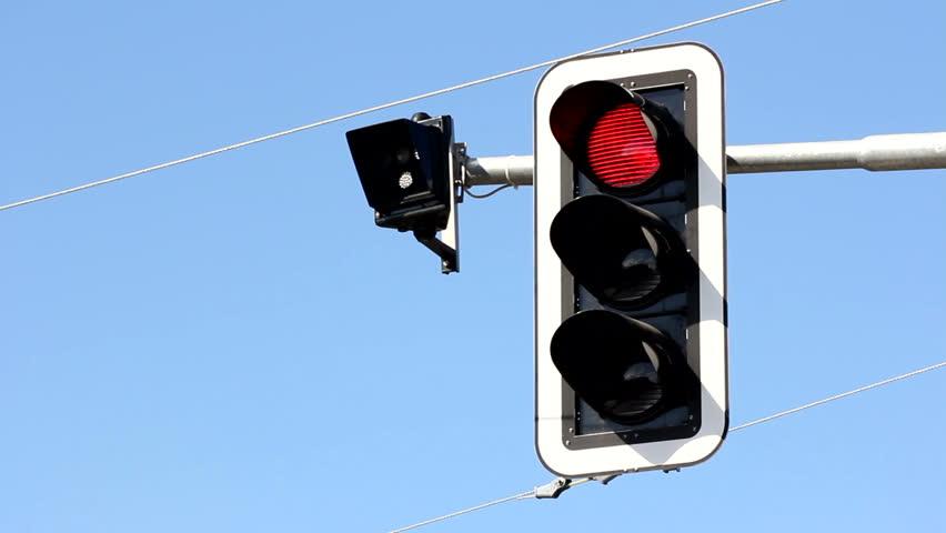 Hanging traffic light regulates cars and trams traffic