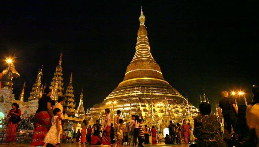 YANGON, MYANMAR- OCT 30 : Tourists visit Shwedagon Pagoda at nighttime in Yangon ,Myanmar on October 30,2015.