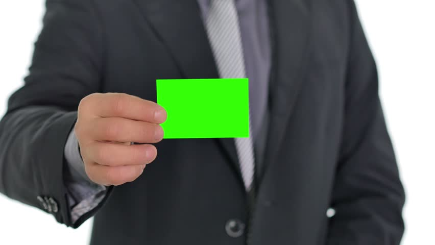 business man giving a green business card to the camera close up on hand