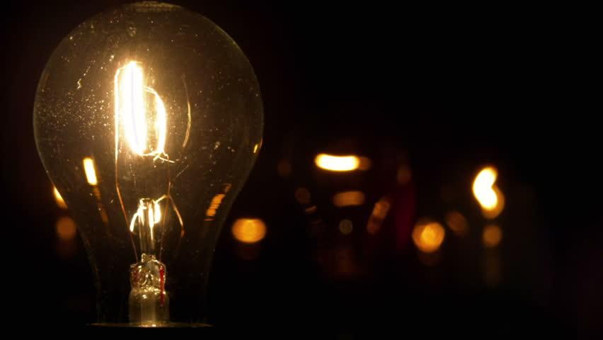 A light bulb illuminates a dark room, much like an idea in our mind.