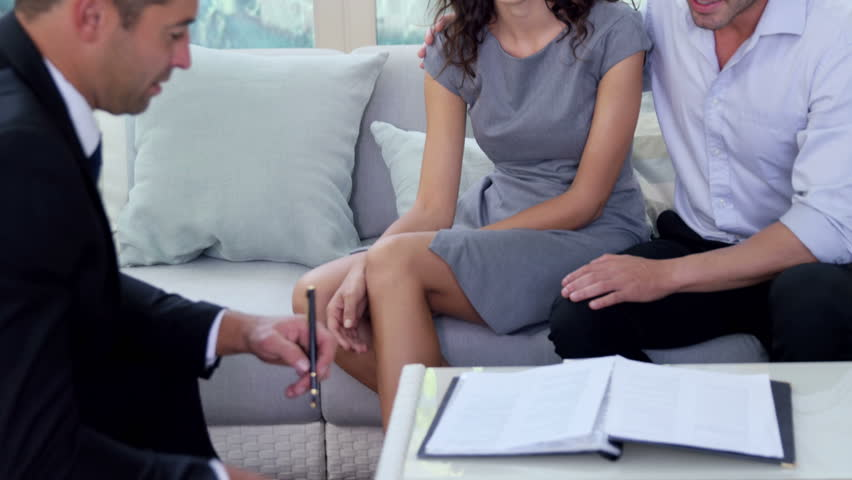 Happy couple signing a house contract with real estate agent - HD stock footage clip