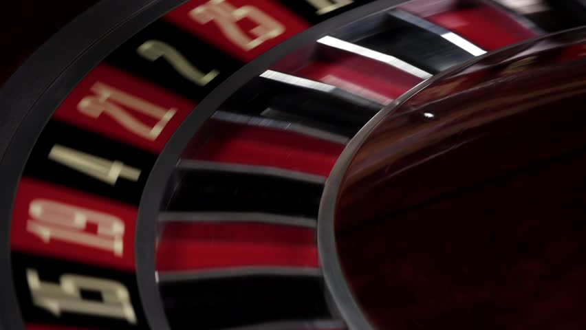 Fast running wheel of roulette, white ball falls, close up | Shutterstock HD Video #14306860
