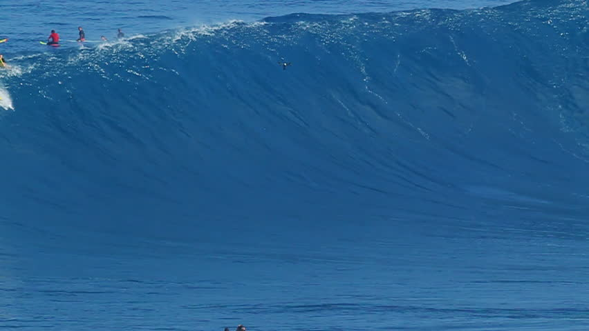"MAUI, HI - JANUARY 28, 2016: Professional surfer rides a giant wave at the legendary big wave surf break known as ""Jaws"" on one the largest swells in recent history. 
