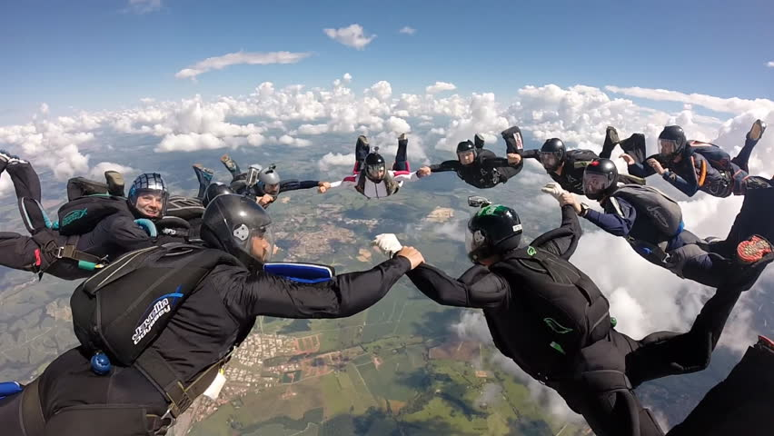 Skydiving holding hands | Shutterstock HD Video #14331466