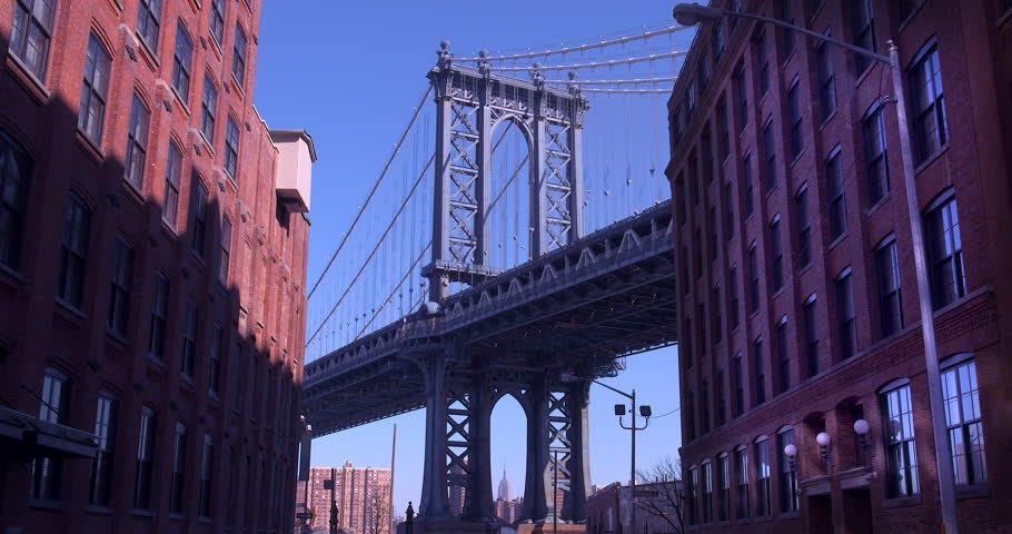 The Iconic Manhattan Bridge Viewed From Dumbo, Brooklyn with the Empire State building framed in the bottom of the bridge. (New York, August 2015) | Shutterstock HD Video #14387977